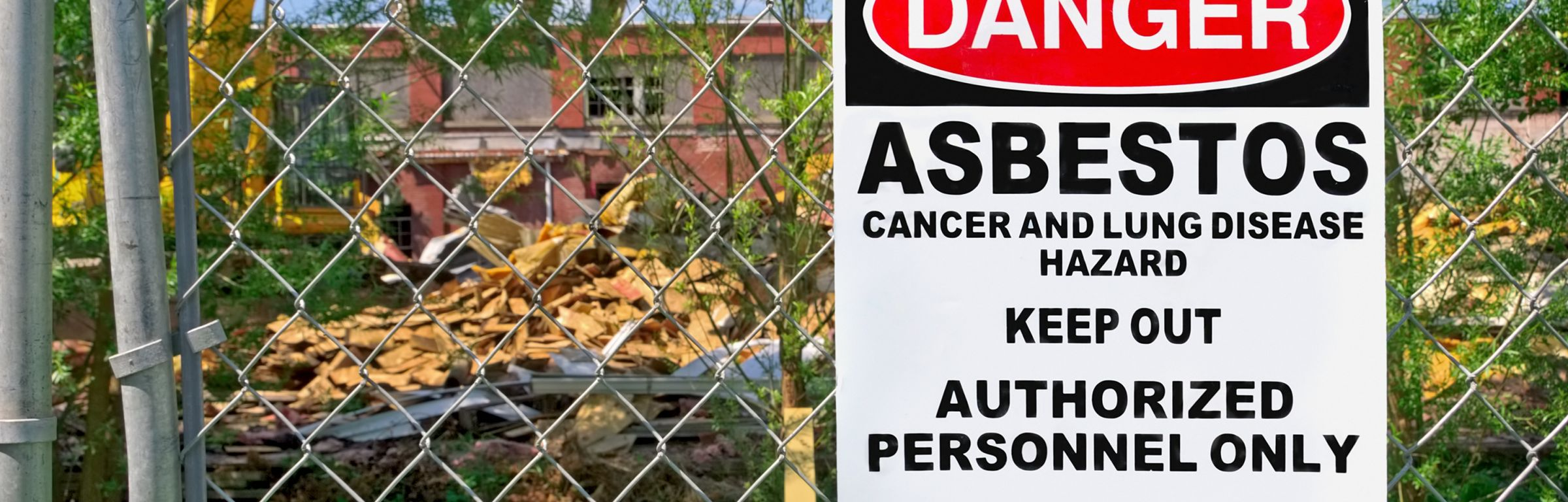 Danger sign of asbestos outside restricted area